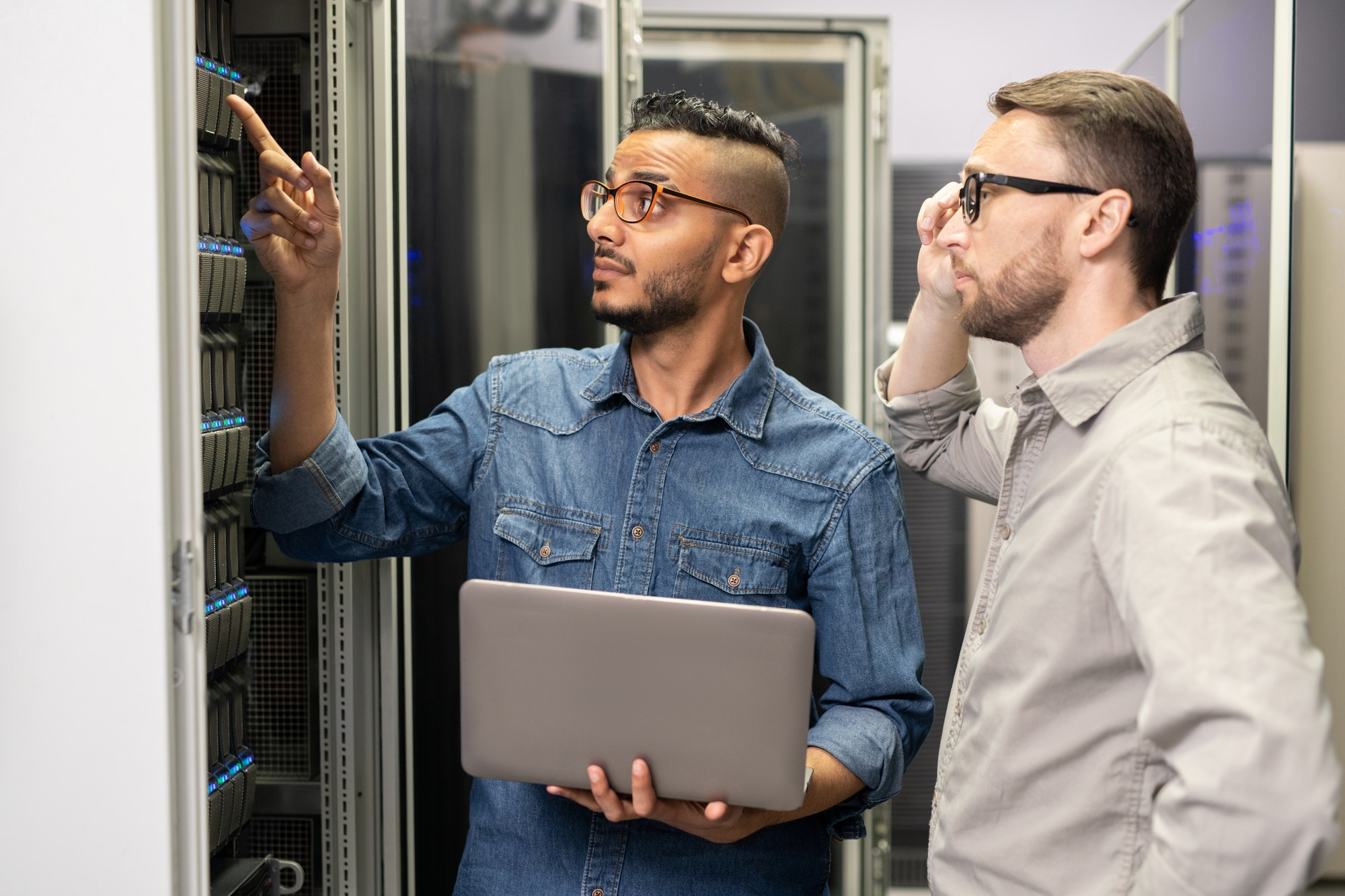Network engineers working with supercomputer